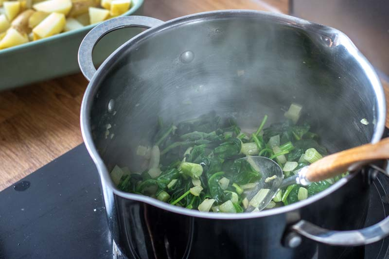 Spinach and other ingredients in pan