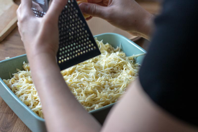 cheese being grated on top