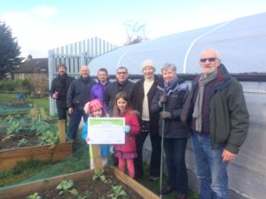 Garden volunteers with Pledge