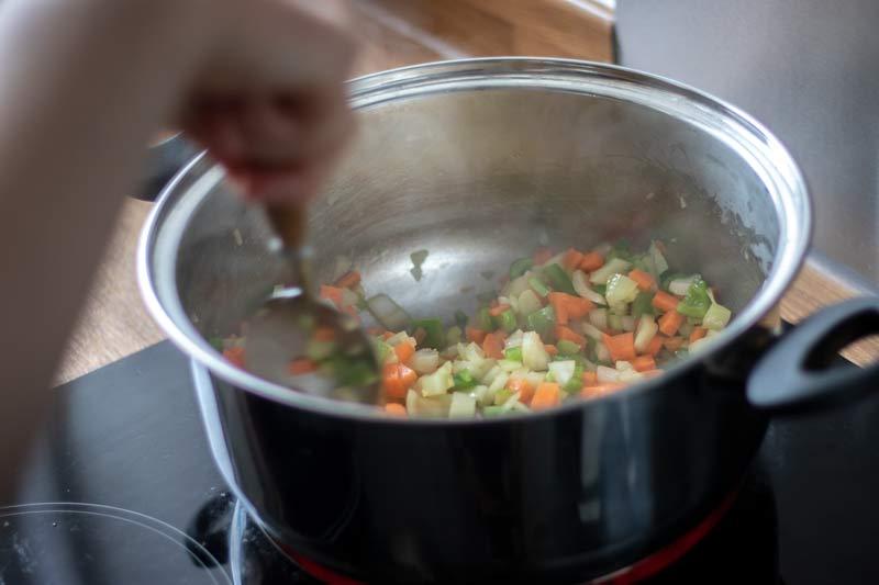 Vegetables frying in pot