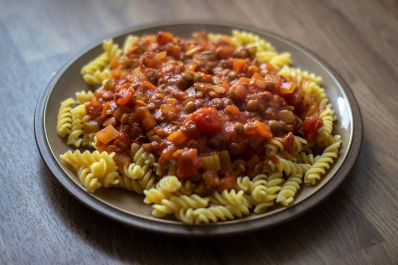 Vegetable ragu served on pasta