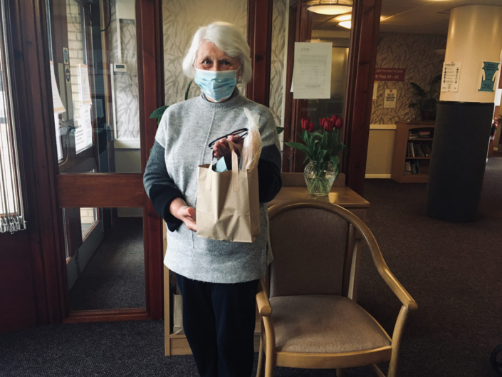 Ann Polson, Bield resident, receives food from EATS Rosyth